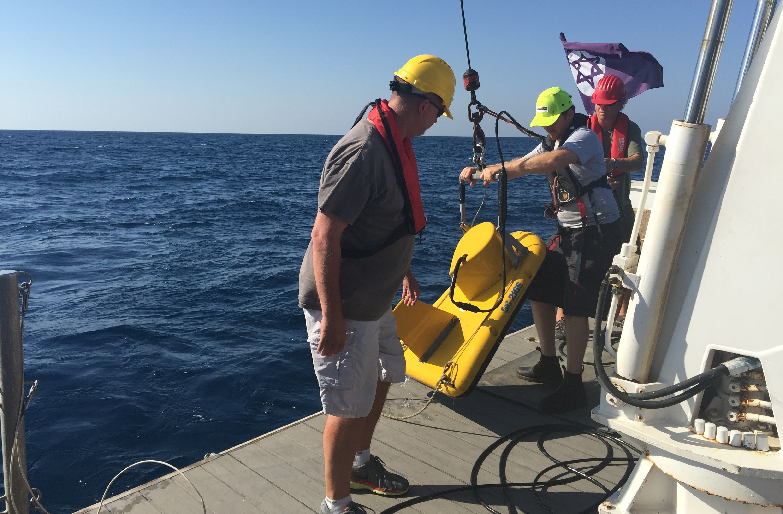 Scientists deploy scientific equipment in the Mediterranean Ocean