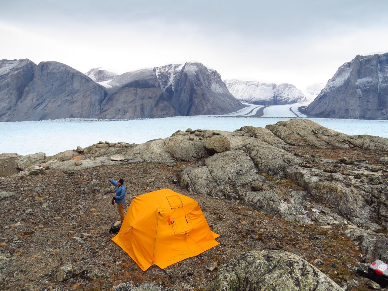 Tent set up by an ice sheet in Greenland.