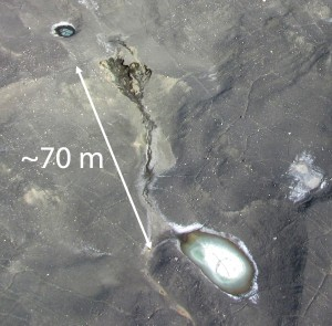 Melt out of a thermokarst gully in Garwood Valley, McMurdo Dry Valleys as seen from a helicopter. Melting ancient ice is accelerated by the presence of shallow groundwater and hypersaline ponds. (Photo courtesy Joseph Levy)