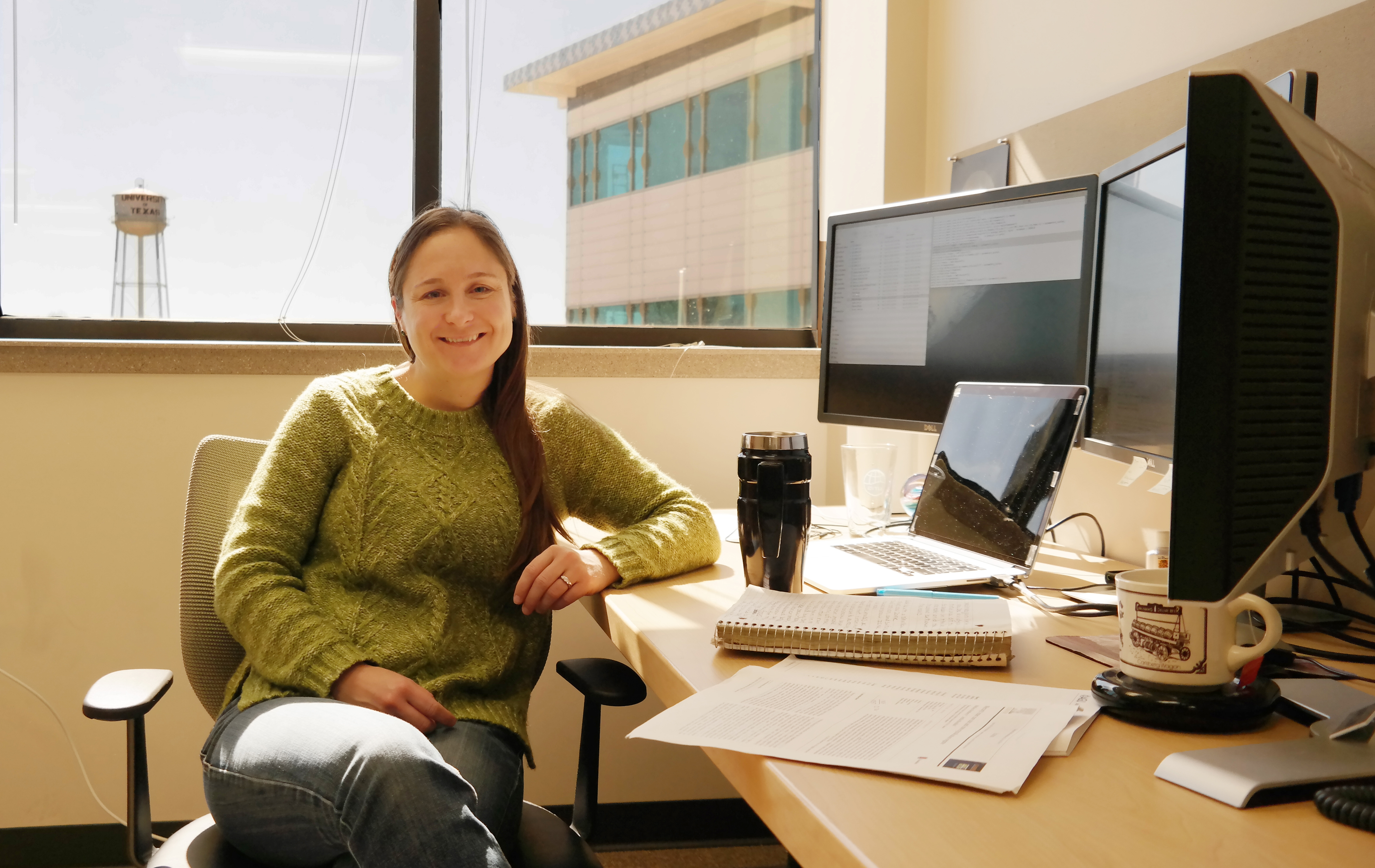 Krista Soderlund sits at her desk on the JJ Pickle Research Campus