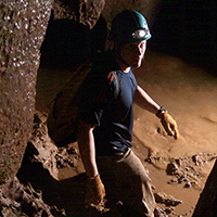 Man spelunking in Philippines