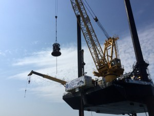 A group of scientists is transported via a lift basket from the transport vessel to the deck of the L/B Myrtle, which is approximately 10 meters above the ocean's surface. (Photo courtesy Sean P.S. Gulick)