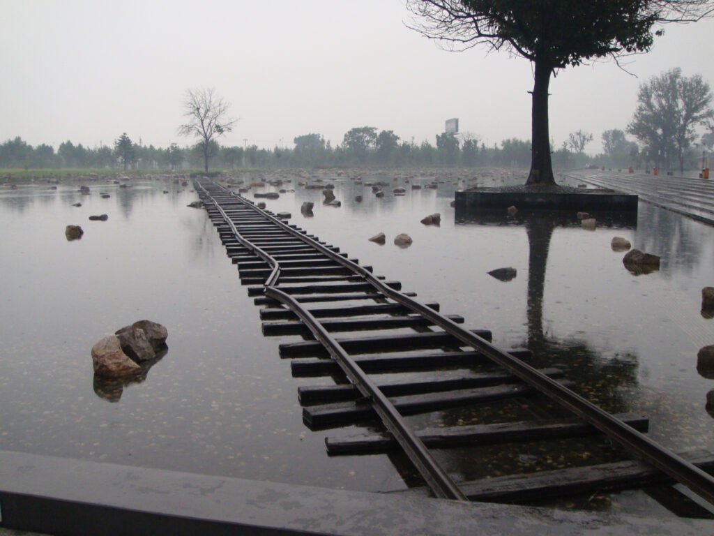 A twisted, disused railway line runs across a flooded plain at the site of China's deadliest quake in modern times.