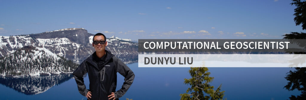 Dunyu Liu standing in front of mountain and lake