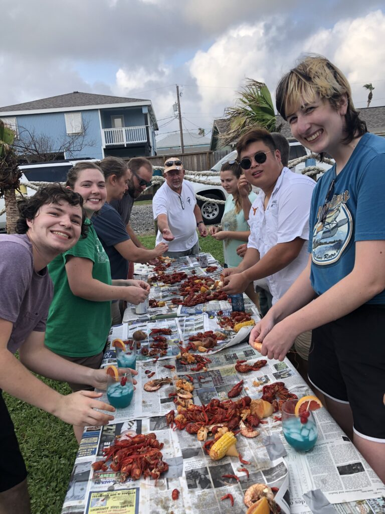 Students at a crawfish boil. Happy times.
